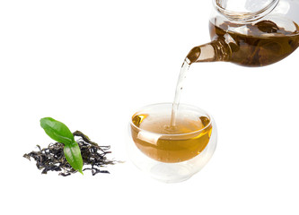 Tea is brewed in a transparent and green tea leaves