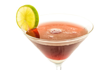 Glass of alcogolic cocktail isolated on white