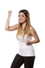 happy young woman with a winning gesture