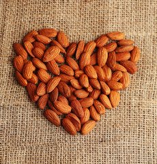 Almonds on sackcloth background