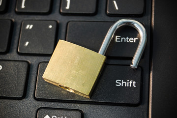 open security lock on black computer keyboard
