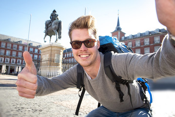 backpacker tourist taking selfie photo mobile phone outdoors