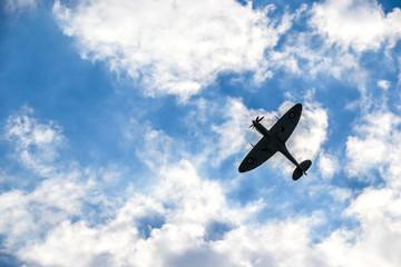 Spitfire on blue cloudy sky over Bratislava