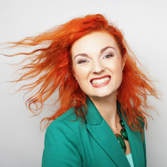 happy woman with wind in hair