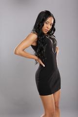Cute caribbean in little black dress