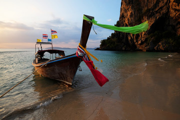 Boat Thai in The beautiful miracle beach & crystal clear water a