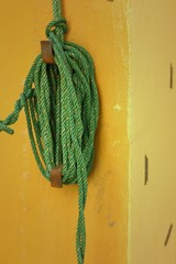 Green rope was tied to a pole.