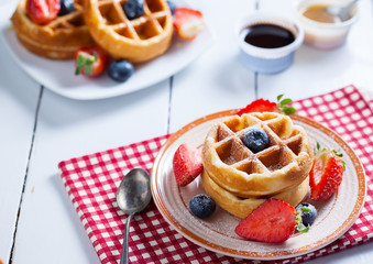 waffles with strawberry ,blueberry and caramel sauce