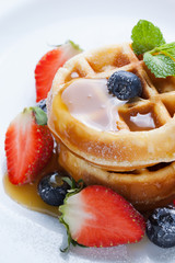 waffles with strawberry and blueberry and caramel sauce