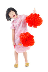 Asian girl in traditional cloth holding chinese lantern