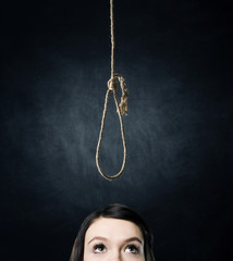 A woman looks at a loop before committing suicide.