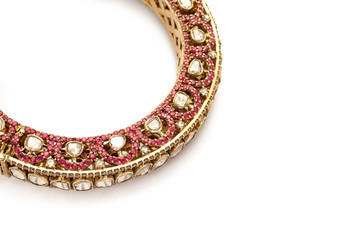 Close up of designer gold and diamond bangle