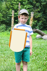 Cheerful boy with a wooden shield and sword