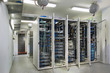 Leinwanddruck Bild - Server room. With iron light cabinets whose doors are open.
