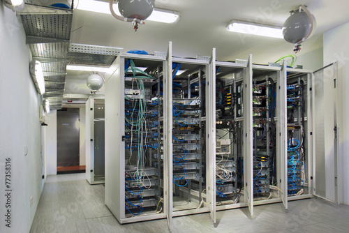 Leinwanddruck Bild Server room. With iron light cabinets whose doors are open.