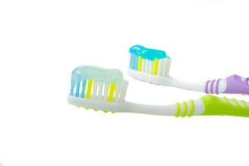 A toothbrush with toothpaste on isolated