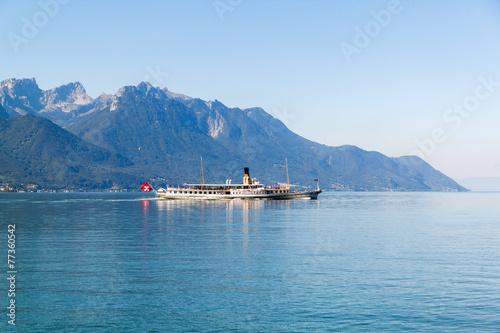 A boat floating in Geneva lake in Switzerland © fischers