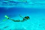 Woman with mask snorkeling