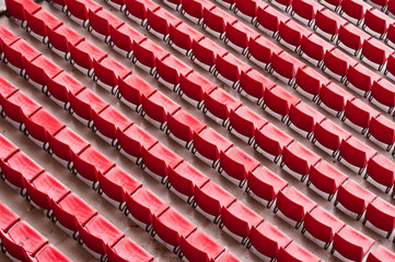 Empty ranges of red seats in a stadium