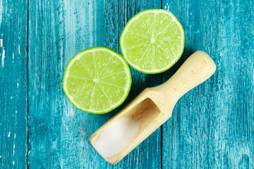 Lime and salt on blue wood background
