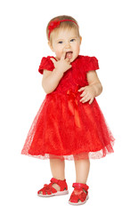 Baby Girl in Red Dress. Happy Kid in Fashion Holiday Clothes