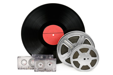 audio cassettes, records and film strip isolated on white backgr