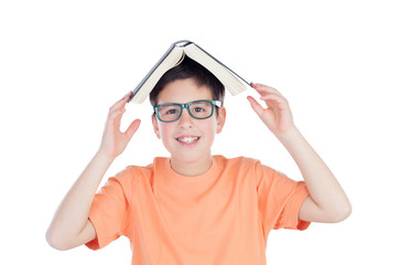 Funny teenage boy of thirteen with a book on head