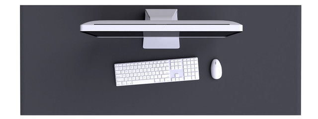 Top view of workspace with computer and other elements on table.