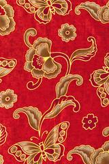 Beautiful gold pattern on red batik