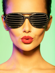 Fashion portrait of  woman wearing black sunglasses with diamond