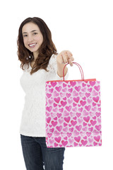Happy woman showing gift bag