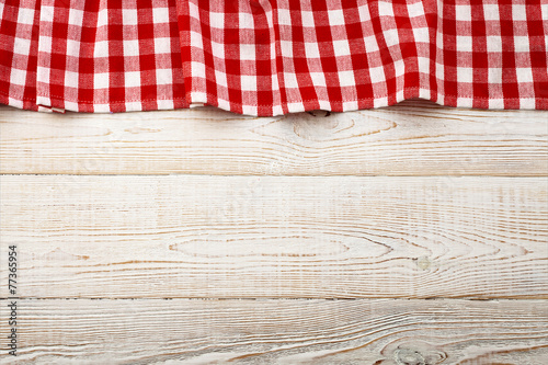 Fotobehang Boord Top view of checkered tablecloth on white wooden table.