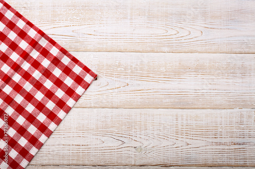 Top view of checkered tablecloth on white wooden table. - 77365972
