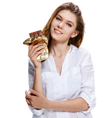 young woman holding big chocolate bar, healthy food concept