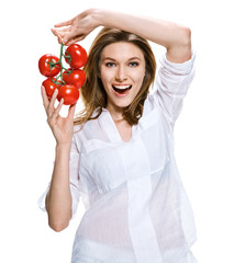 Healthy lifestyle woman holding a bunch of tomatoes in her hands