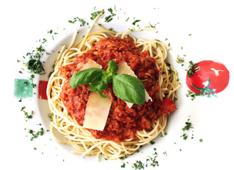 Spagetti on white plate with basil