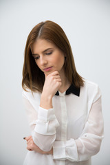 Portrait of a pensive businesswoman looking away