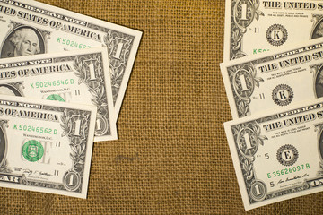 Banknotes US  $1  dollars on a old sacking