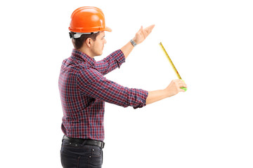 An architect working with a tape measure