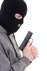 profile view of criminal man in mask holding gun isolated on whi
