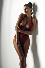 Girl in a red bathing suit