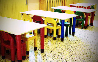 small benches and small colored chairs