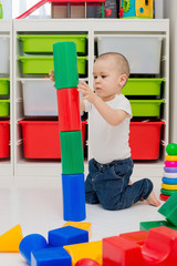 child builds a tower of cubes
