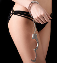 Bdsm concept with handcuffs.