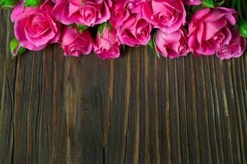 rosebuds on wooden background