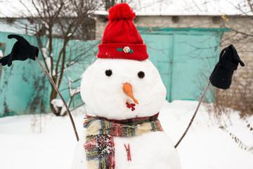 Snowman in a red cap