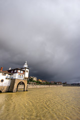 Getxo seafront and Arriluze lighthouse with stormy weather