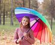 happy girl with umbrella outdoor