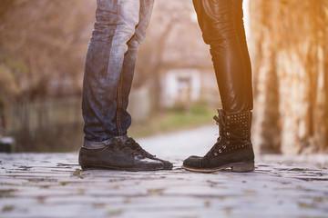 man woman couple feet