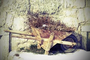 wheelbarrow abandoned wood